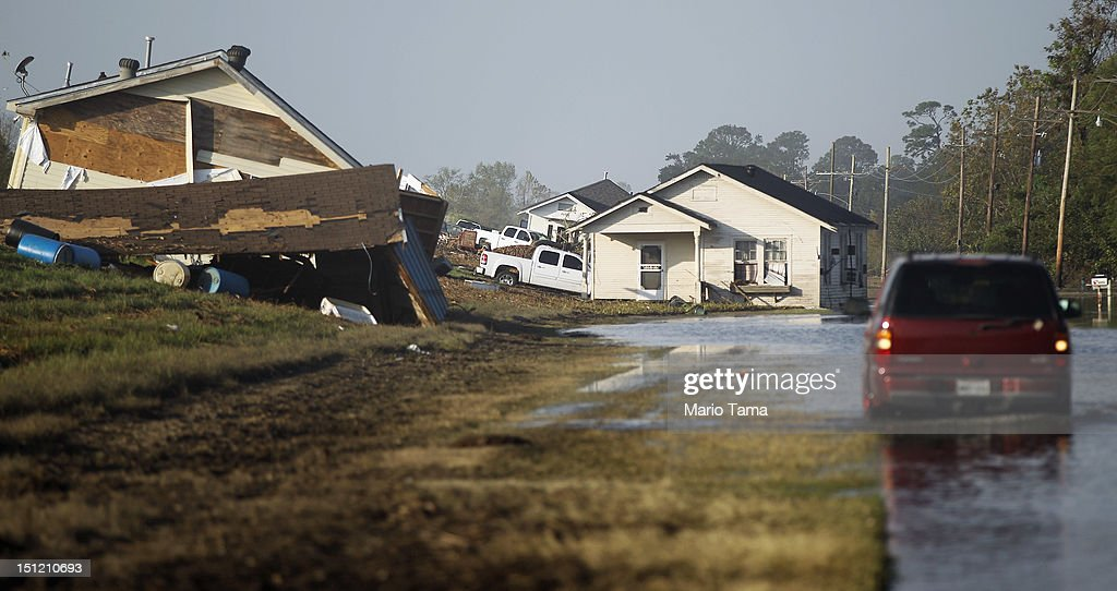 Homes are washed up onto the side of a levee from Hurricane Isaac flooding in Plaquemines Parish on September 3, 2012 in Braithwaite, Louisiana. Damage totals from the storm could top $2 billion and more than 125,000 customers are still without power six days after the storm made landfall.