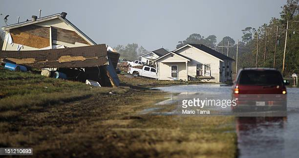 Homes are washed up onto the side of a levee from Hurricane Isaac flooding in Plaquemines Parish on September 3 2012 in Braithwaite Louisiana Damage...