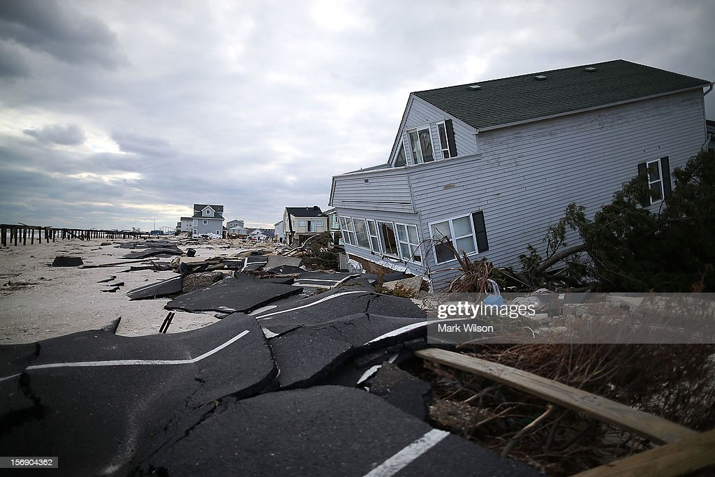 Homes badly damaged by Superstorm Sandy remain off limits to owners on November 24, 2012 in Ortley Beach, New Jersey. New Jersey Gov. Christie estimated that Superstorm Sandy will cost New Jersey $29.4 billion in damage and economic losses.