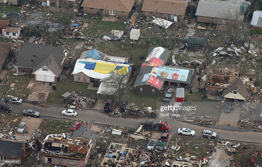 Homes damaged and destroyed by a tornado line a street on May 24, 2013 in Moore, Oklahoma. A two-mile wide EF5 tornado touched down in Moore May 20 killing at least 24 people and leaving behind extensive damage to homes and businesses. U.S. President Barack Obama promised federal aid to supplement state and local recovery efforts.