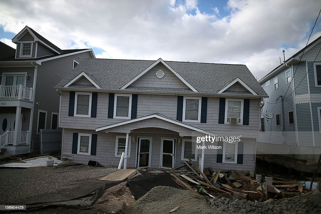 Homes damaged by Superstorm Sandy are deemed structurally unsafe to occupy, on November 24, 2012 in Ortley Beach, New Jersey. New Jersey Gov. Christie estimated that Superstorm Sandy will cost New Jersey $29.4 billion in damage and economic losses.