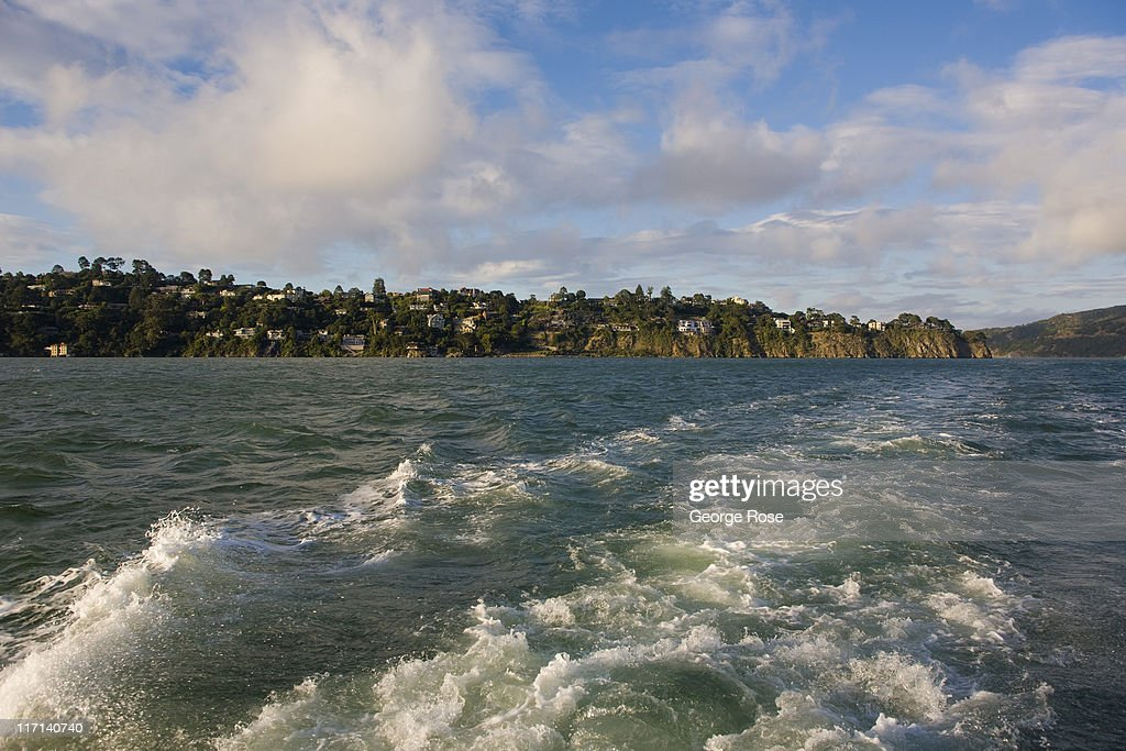 Homes line the hillside near Tiburon as viewed from the back of a tour boat on June 11, 2011 in Sausalito, California. The San Francisco Bay is home to thousands of sailing enthusiasts and will be the site of the 2013 America's Cup.