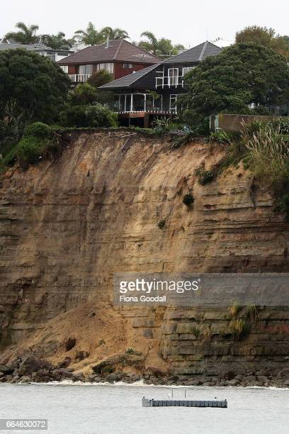 Homes on the edge of the cliff in Sharon Rd Browns Bay face evacuation after overnight slips sent part of their garden into the sea on April 5 2017...