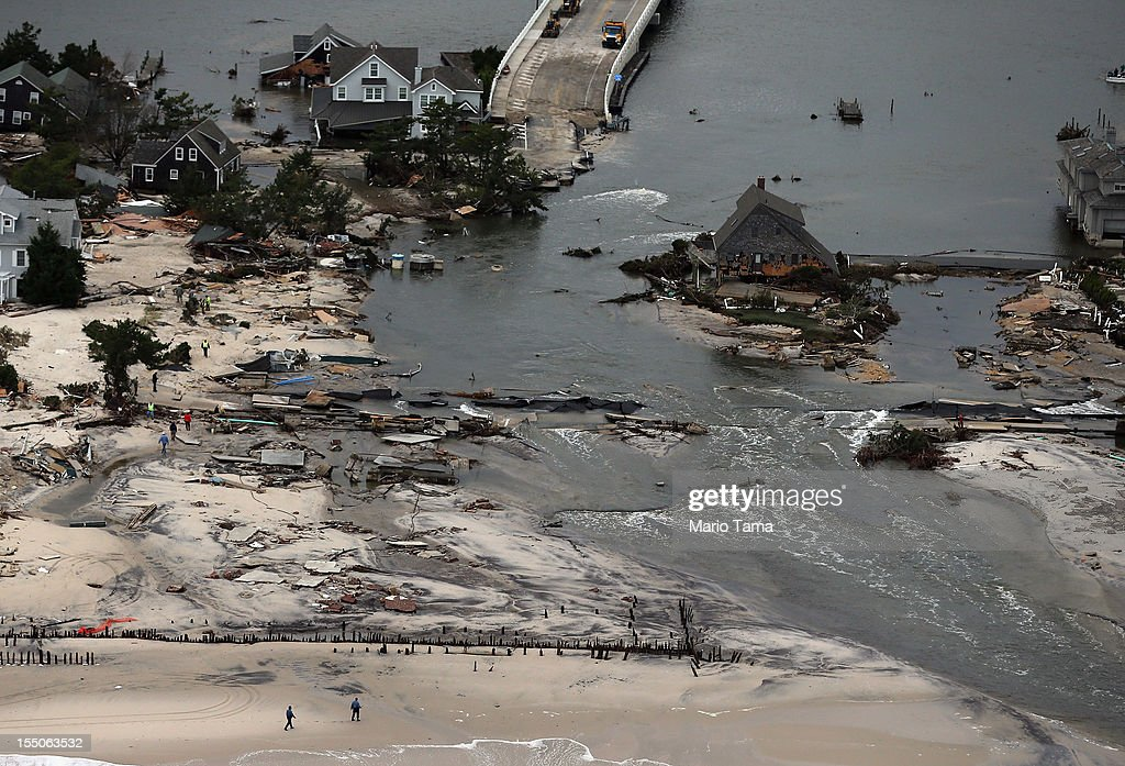 Homes sit in ruin at the end of a bridge wrecked by flooding from Hurricane Sandy on October 31, 2012 in Mantoloking, New Jersey. At least 50 people were reportedly killed in the U.S. by Sandy with New Jersey suffering massive damage and power outages.