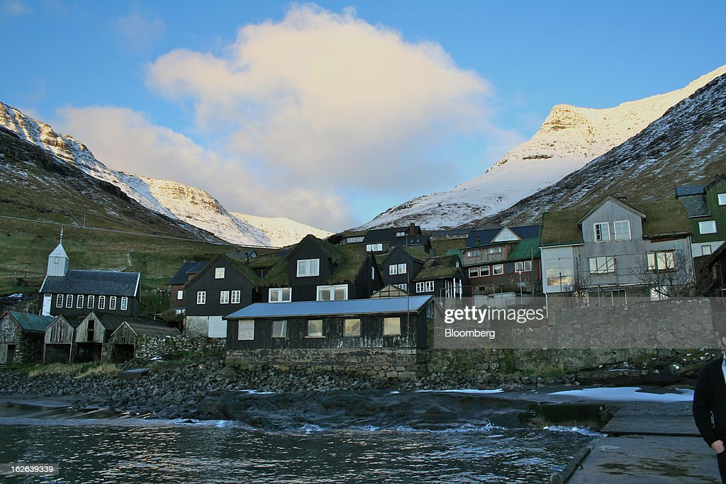 Homes stand in a village on the island of Vagar in the western Faroe Islands, under the sovereignty Denmark, on Friday, Dec. 7, 2012. A proposed plan would decipher the complete DNA sequence of the 50,000 citizens of this tiny, windswept land halfway between Scotland and Iceland, from its fishermen to the prime minister. Scientists already see the Faroes becoming a model for the use of human genomes. Photographer: John Lauerman/Bloomberg via Getty Images