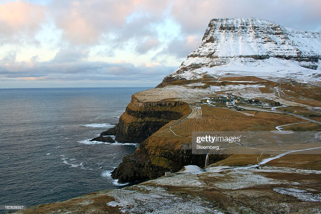 Homes stand in a village on the island of Vagar in the western Faroe Islands, under the sovereignty of Denmark, on Friday, Dec. 7, 2012. A proposed plan would decipher the complete DNA sequence of the 50,000 citizens of this tiny, windswept land halfway between Scotland and Iceland, from its fishermen to the prime minister, using the data for medical treatment and research. Scientists already see the Faroes becoming a model for the use of human genomes. Photographer: John Lauerman/Bloomberg via Getty Images