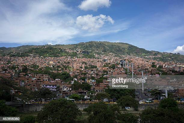Homes stand in the Comuna neighborhood of Medellin Colombia on Wednesday July 16 2014 Colombia's growth in the second quarter was likely close to 5...