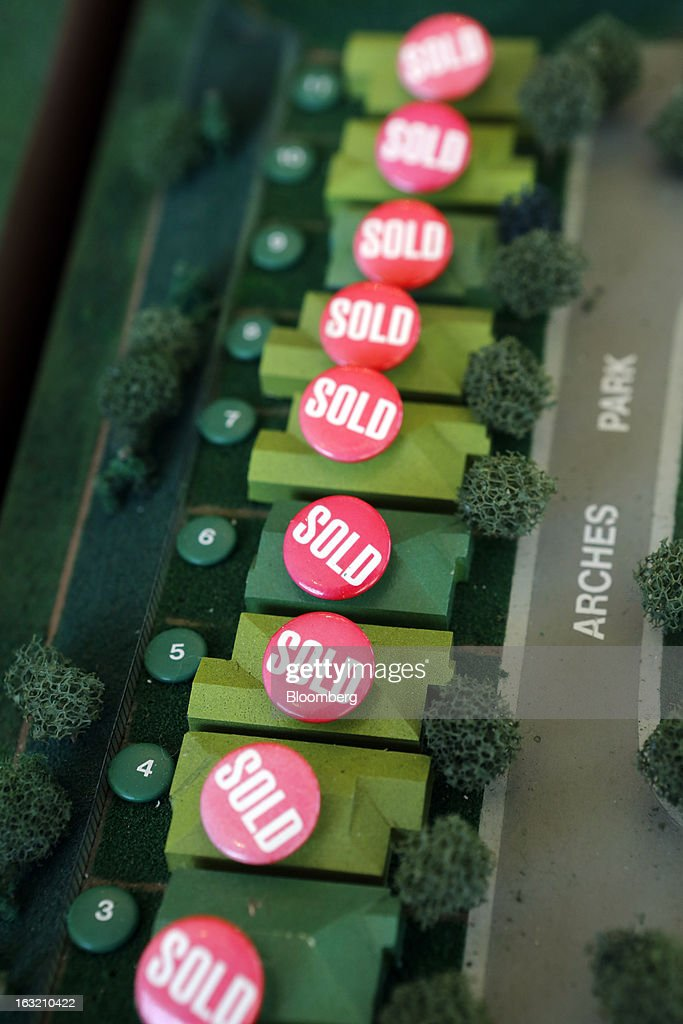 Homes that have been sold are marked with buttons on a model in the sales office of Hovnanian Enterprises Inc.'s Four Seasons housing development in Beaumont, California, U.S., on Monday, March 4, 2013. Hovnanian Enterprises Inc., the best-performing U.S. homebuilder stock in the past 12 months, reported a narrower loss for its fiscal first quarter as sales and orders increased amid a housing rebound. Photographer: Patrick T. Fallon/Bloomberg via Getty Images