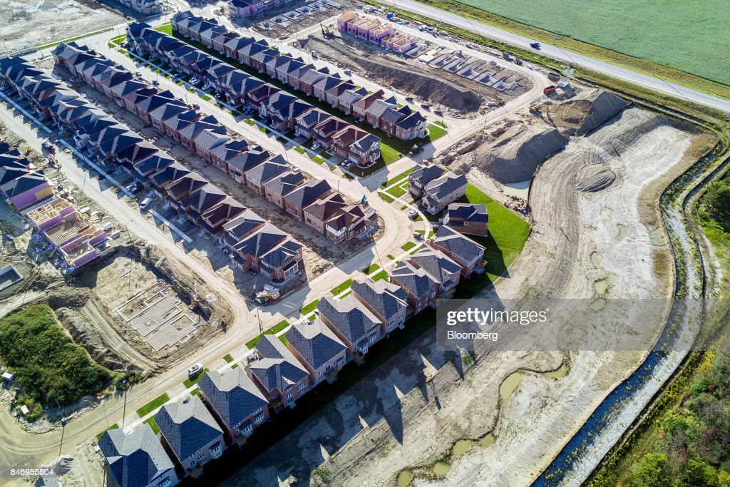 Homes under construction are seen in this aerial photograph taken above Brampton, Ontario, Canada, on Saturday, Sept. 9, 2017. Toronto home builders are showing no signs of concern about the city's housing market. New construction has averaged just over 42,000 annualized between January and August, the highest first eight months of a year since 2012. Photographer: James MacDonald/Bloomberg via Getty Images