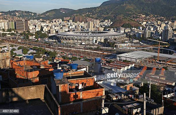 Homes within the Mangueira community or 'favela' overlook the famed Maracana Stadium on June 5 2014 in Rio de Janeiro Brazil Maracana will host the...