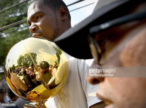 Hometown hero Kevin Durant an NBA Champion and MVP holds the trophy August 17 2017 in Seat Pleasant MD