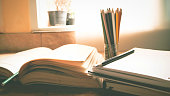 A book is opening with pencil on desk in summer