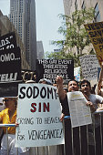A homophobic demonstration during Gay Pride Day in New York City 29th June 1986 The protestors hold placards reading 'Sodomy Sin Crying to heaven for...