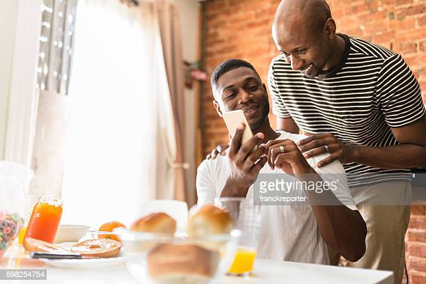 homosexual couple doing breakfast on the kitchen togetherness