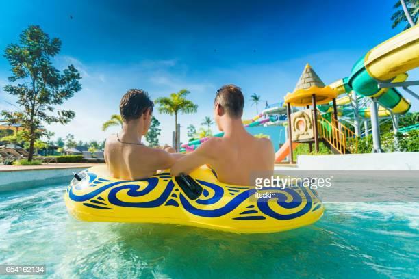 Homosexual couple having fun in waterpark