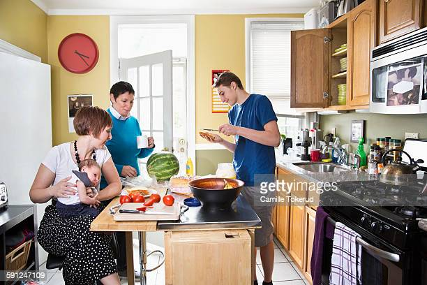 Homosexual couple in kitchen with children