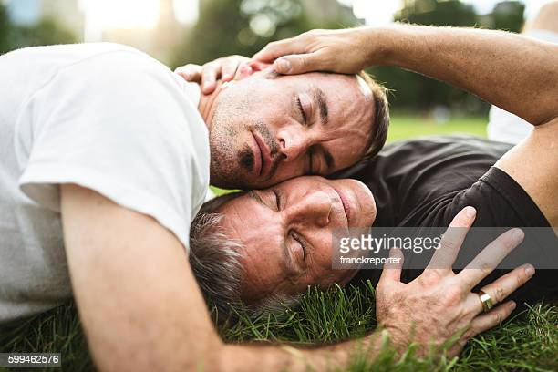 homosexual couple relaxing togetherness on the park