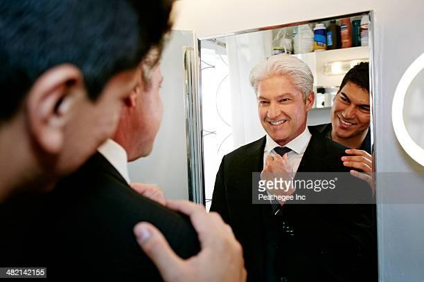 Homosexual couple smiling in mirror