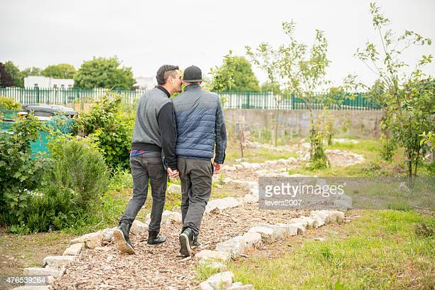 Homosexual couple together on their allotment