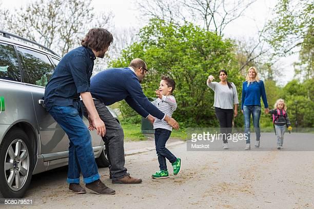 Homosexual families enjoying on street