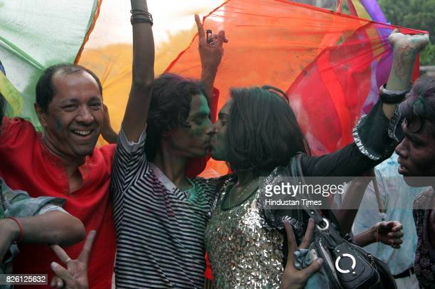 Homosexual Gay Kiss Kissing Gay rights activists cheer and celebrate after the Delhi High Court passed a ground breaking ruling on Thursday at Kalina...