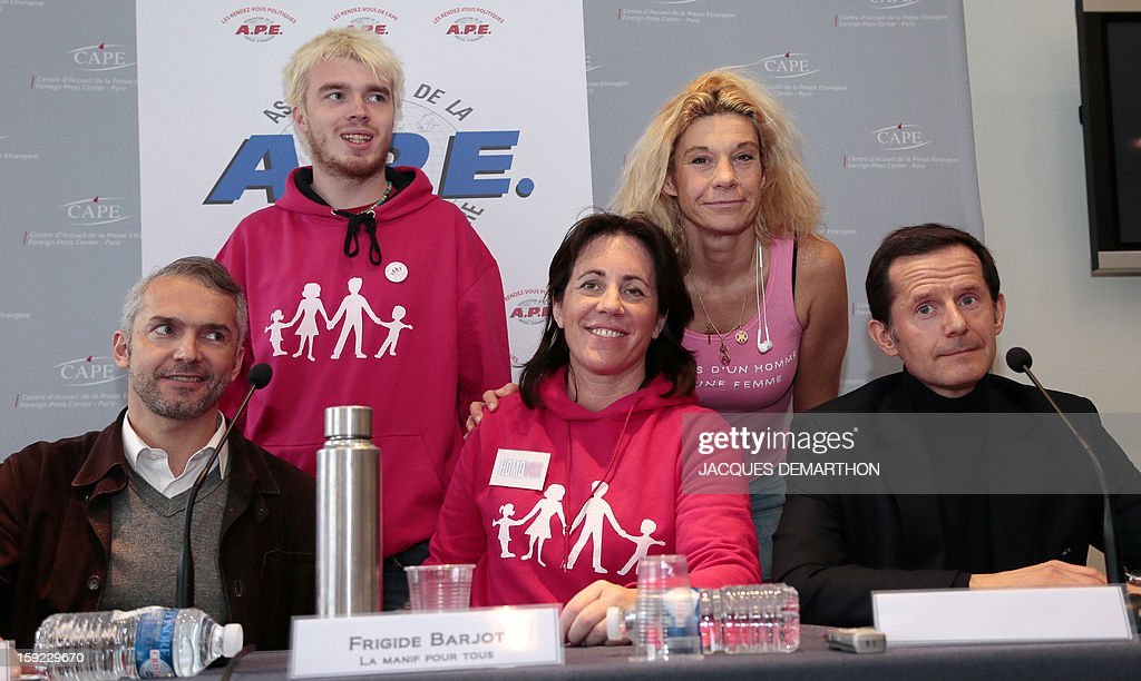 'Homovox' association members Benoît D'Halluin, Nathalie de Williencourt, Emmanuel Ducamp, (L to R 2d row) Xavier Bongibault, founder of 'Plus gay sans mariage' and Virginie Tellene, known as 'Frigide Barjot', pose on January 10, 2013 in Paris after a press conference about the demonstration against gay marriage on January 13, 2013.