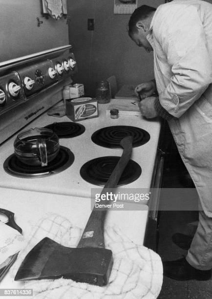 Homowner Surprised by Burglary In photo at left Ken Pennel Police Department Identification Bureau investigator looks for fingerprints in kitchen of...