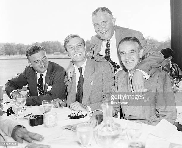 Hon Henry L Ughetta Hon Franklin D Roosevelt Jr Hon James J Lyons and Hon William Averill Harriman seated at a dining table in an open air restaurant...