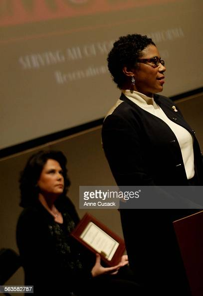 Honaree Susan Rae Garrison who has worked for Sydney Poitier for years speaks after receiving her award and organizer Kerri Campos listens Kerri...