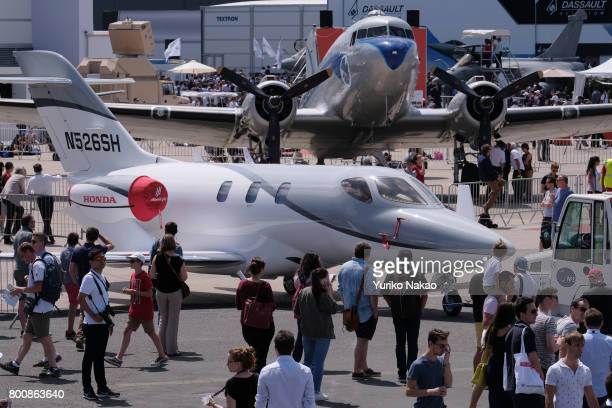 Honda Aircraft Co's HondaJet bizjet is towed through the Le Bourget Airport as people visit on the first public day of the 52nd International Paris...
