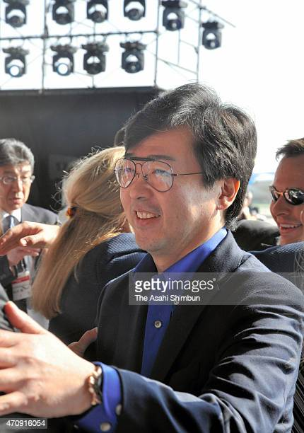 Honda Aircraft President Michimasa Fujino speaks to media reporters in front of HondaJet at a hangarat Tokyo International Airport on April 23 2015...