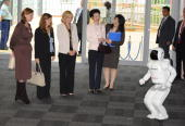 Honda Asimo robot greats Sarah Brown wife of United Kingdom Prime Minister Gordon Brown Margarida Sousa Uva wife of European Union President Jose...