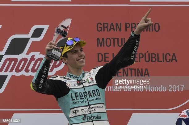 Honda biker Joan Mir of Spain celebrates at the podium after wining the Moto3 race of the Argentina Grand Prix at Termas de Rio Hondo circuit in...