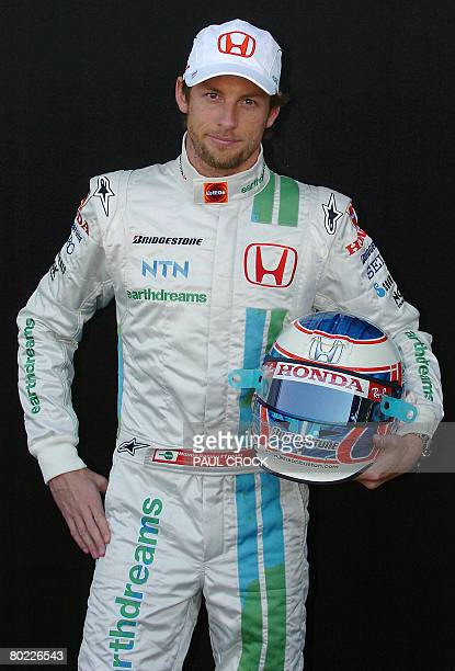 Honda driver Jensen Button of Britain poses with his helmet during the leadup to the Australian Formula One Grand Prix on Melbourne 13 March 2008 The...