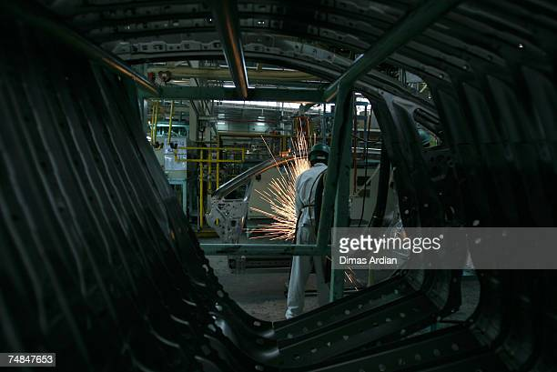 Honda employee works on the vehicle production line at the Honda Factory on Thursday June 21 2007 in Karawang West Java Indonesia The former CEO of...