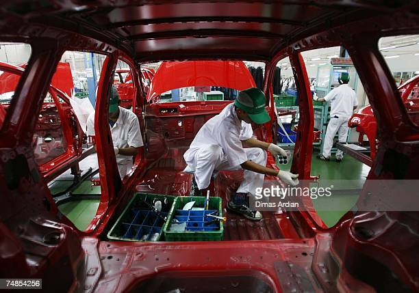 Honda employee works on the vehicle production line at the Honda Factory on June 21 2007 in Karawang West Java Indonesia The former CEO of PT Honda...
