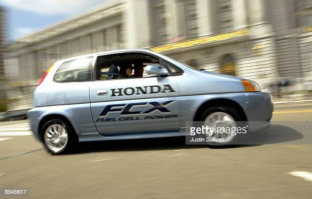 Honda FCX hydrogenpowered fuel cell car drives down the street April 13 2004 in San Francisco California The City and County of San Francisco took...