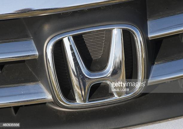 A Honda logo is seen on the hood of a car at an automotive dealership in Landover Hills Maryland December 31 2014 AFP PHOTO / SAUL LOEB