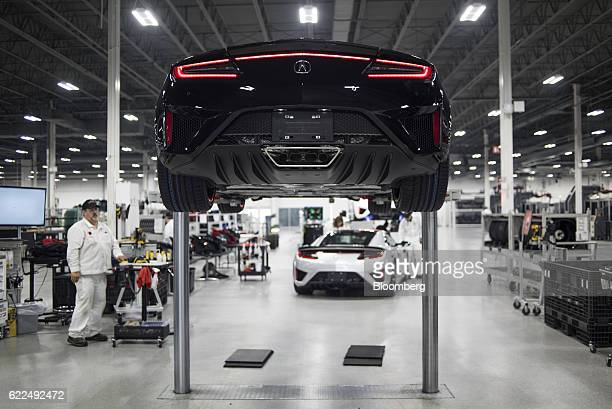 A Honda Motor Co 2017 Acura NSX vehicle sits on a lift at the Honda Performance Manufacturing Center in Marysville Ohio US on Thursday Nov 10 2016...