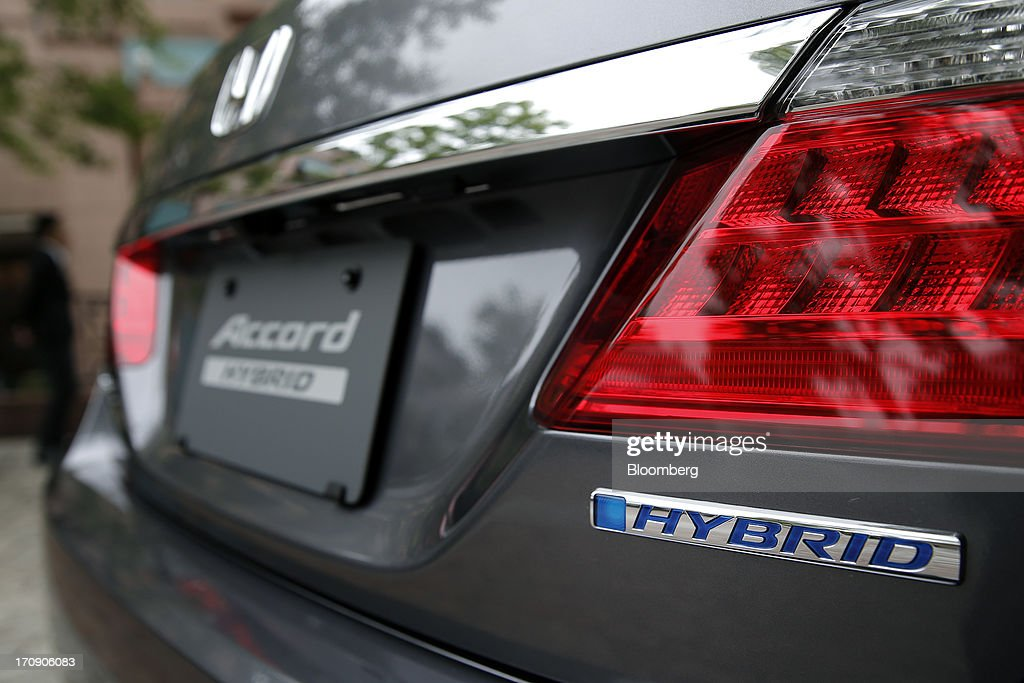 A Honda Motor Co. Accord hybrid sedan is displayed at its unveiling in Tokyo, Japan, on Thursday, June 20, 2013. Honda, Japan's third-largest carmaker, unveiled a hybrid sedan at a 20 percent higher price than Toyota Motor Corp.'s gasoline-electric Camry, betting drivers will pay extra for fuel economy. Photographer: Kiyoshi Ota/Bloomberg via Getty Images