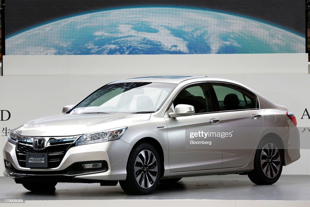 A Honda Motor Co. Accord hybrid sedan sits on display at its unveiling in Tokyo, Japan, on Thursday, June 20, 2013. Honda, Japan's third-largest carmaker, unveiled a hybrid sedan at a 20 percent higher price than Toyota Motor Corp.'s gasoline-electric Camry, betting drivers will pay extra for fuel economy. Photographer: Kiyoshi Ota/Bloomberg via Getty Images