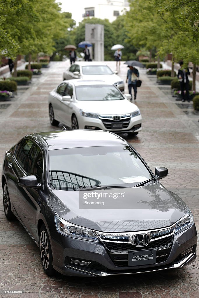 Honda Motor Co. Accord hybrid sedans are displayed at the unveiling in Tokyo, Japan, on Thursday, June 20, 2013. Honda, Japan's third-largest carmaker, unveiled a hybrid sedan at a 20 percent higher price than Toyota Motor Corp.'s gasoline-electric Camry, betting drivers will pay extra for fuel economy. Photographer: Kiyoshi Ota/Bloomberg via Getty Images