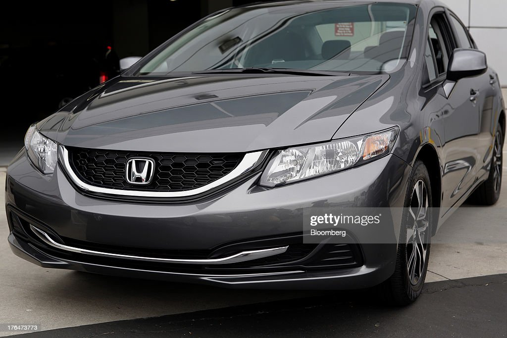 A Honda Motor Co. Civic vehicle with the Pandora Media Inc. integrated entertainment sits at American Honda Motor Co. Inc. headquarters in Torrance, California, U.S., on Tuesday, Aug. 13, 2013. Honda Motor Co. has sold 218,000 Accords, and 191,000 Civics in the first 7 months of 2013, all standard with the integrated Pandora system. Photographer: Patrick Fallon/Bloomberg via Getty Images