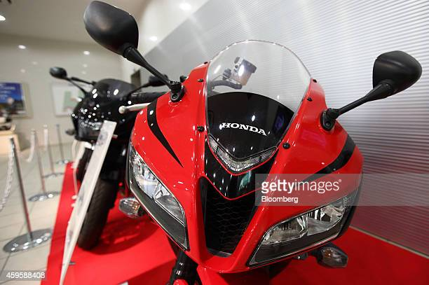 Honda Motor Co motorcycles are displayed at the company's Kumamoto factory in Ozu Kumamoto Prefecture Japan on Tuesday Nov 25 2014 Honda announced...
