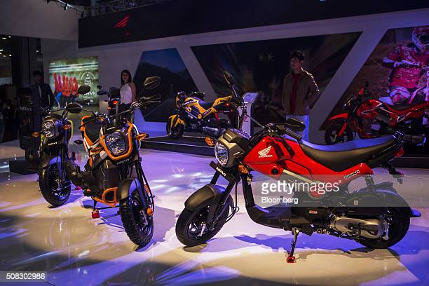 Honda Motor Co Navi motorcycles sit on display at the Auto Expo 2016 in Noida Uttar Pradesh India on Thursday Feb 4 2016 The motor show opened to the...