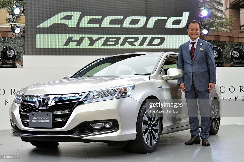 Honda Motor Co President <a gi-track='captionPersonalityLinkClicked' href=/galleries/search?phrase=Takanobu+Ito&family=editorial&specificpeople=5696906 ng-click='$event.stopPropagation()'>Takanobu Ito</a> introduces new 'Accord Hybrid' is displayed at its launching on June 20, 2013 in Tokyo, Japan. The car, carrying hybrid system of 30-kilometer-per-litre fuel efficiency, will be on sale in Japan on June 21.