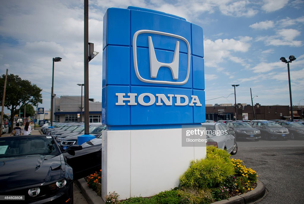 Honda Motor Co signage is displayed at the Paragon Honda dealership in the Queens borough of New York US on Monday Sept 1 2014 Domestic and total...