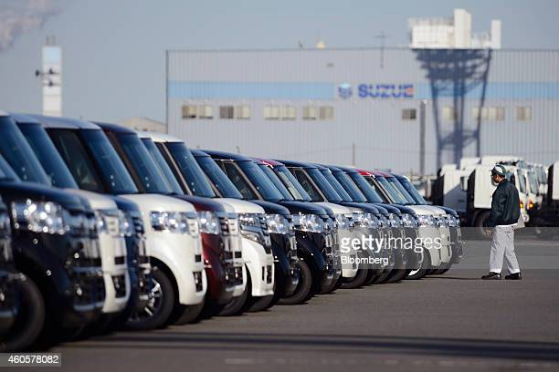 Honda Motor Co vehicles bound for shipment sit at a yard in Yokohama Japan on Monday Dec 15 2014 Japans exports rose less than forecast in November...