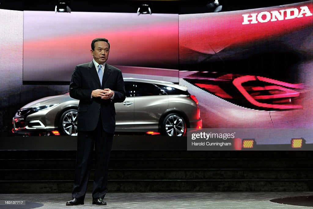 Honda Motor Company, CEO Takanobu Ito delivers a speech next to the Honda Civic Tourer Concept on during the 83rd Geneva Motor Show on March 5, 2013 in Geneva, Switzerland. Held annually the Geneva Motor Show is one of the world's five most important auto shows with this year's event due to unveil more than 130 new products.