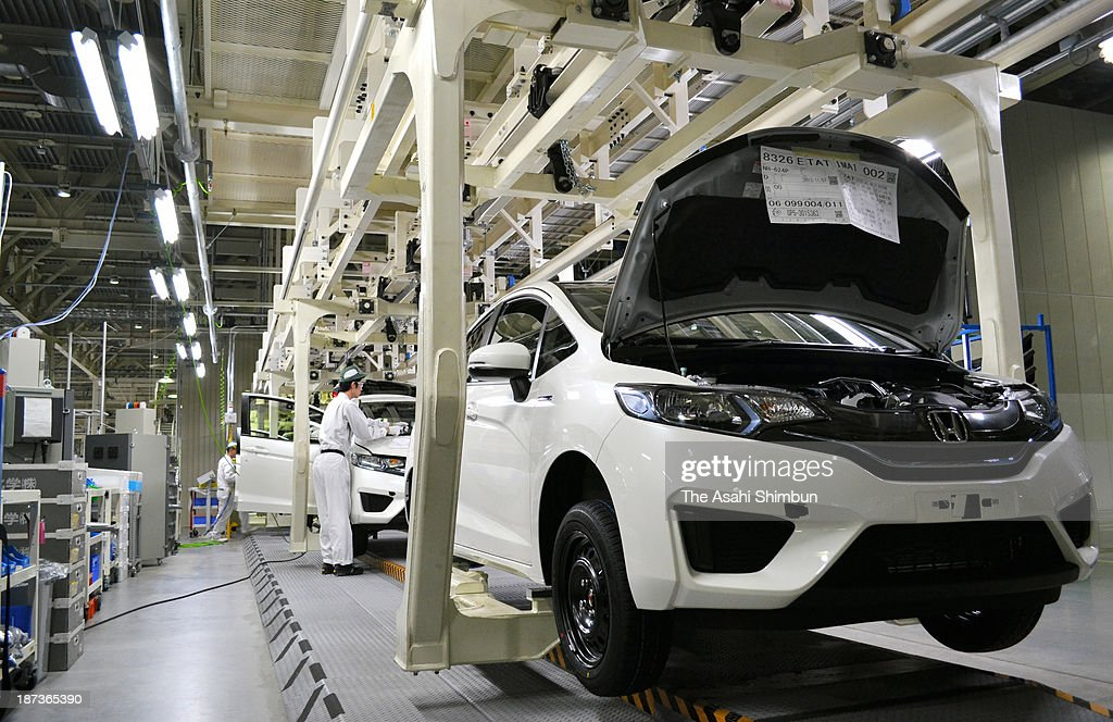 Honda Motor Co's 'Fit' are moved on the production line at its Yorii Plant on November 7, 2013 in Yorii, Saitama, Japan. The compact hybrid vehicle recorded the top sales over Toyota's Pruis in October 2013.